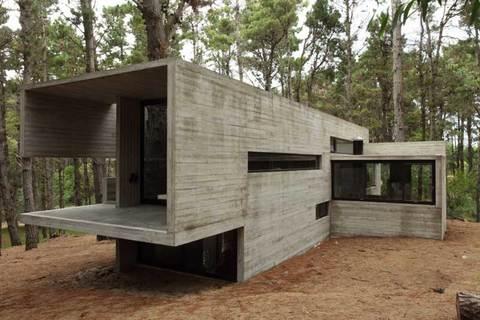 Строительство загородных домов из камня: как выбрать материал для стен?